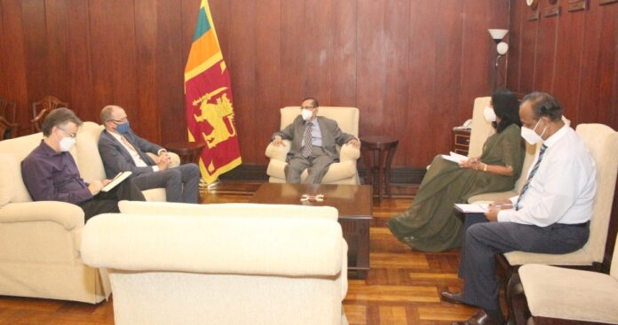 Foreign Minister Prof. G. L. Peiris meets with Canadian High Commissioner David McKinnon